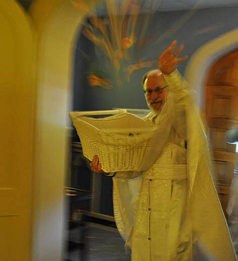 Father Basil of St. John Orthodox Church, Memphis, throws bay leaves with joy during the Holy Saturday liturgy.