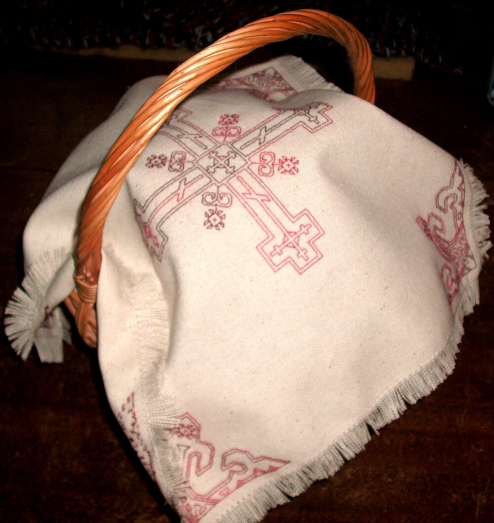 A Pacha basket with an embroidered cover