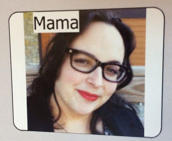 Summer Kinard has dark hair, dark-framed glasses, and bright read lipstick.