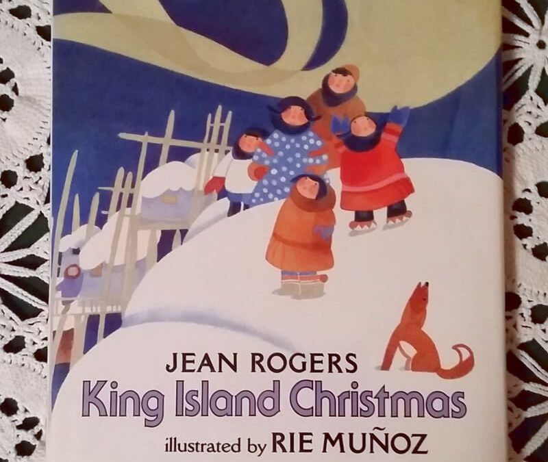 The cover of King Island Christmas shows Native Alaskan children whistling to make the Northern Lights dance