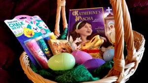 Pascha basket with Catherine's Pascha, sidewalk chalk, an icon of the Nativity, a chocolate bunny, and plastic eggs.