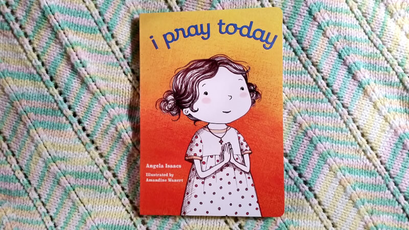The board book, I Pray Today, on a baby blanket