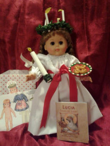 Saint Lucia book with a matching doll