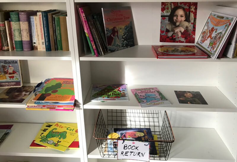 Personal shelves and a book return bin make it easier for children to use the home library