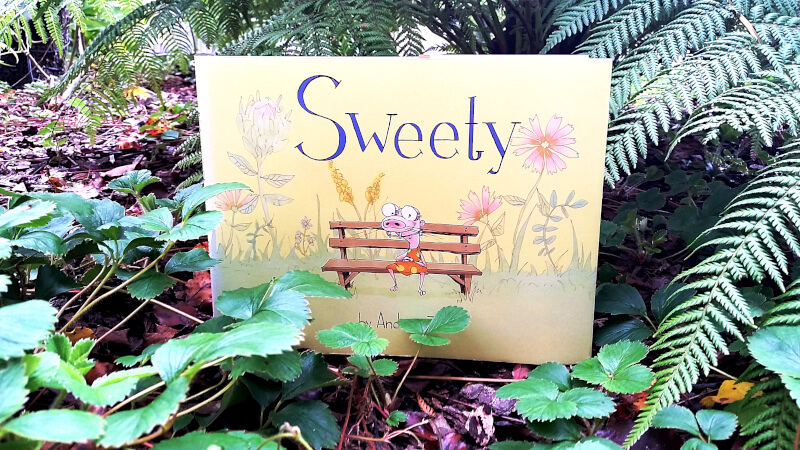 On the cover of Sweety is an odd little girl wearing orthodontic headgear.