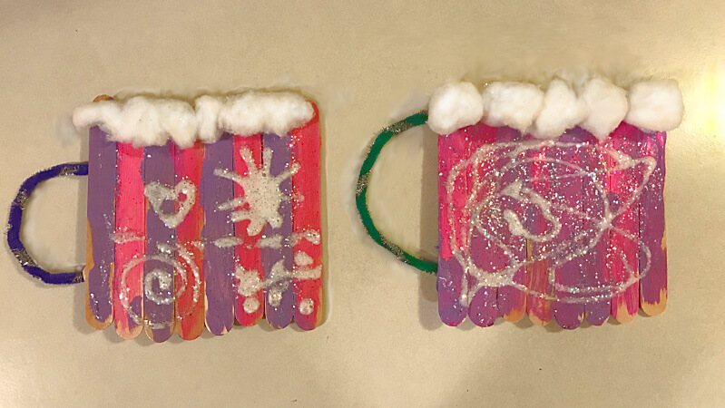 Hot chocolate mugs made out of popsicle sticks, glue, and cotton balls.
