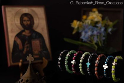 Bracelets adorned with a simple cross.