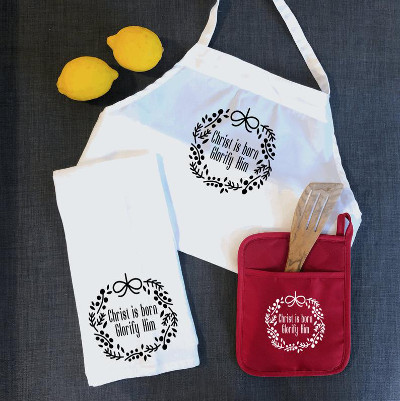 "an apron, tea towel, and pot holder with ""Christ is born!"""