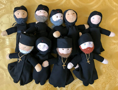 9 small priest, monk, and nun dolls