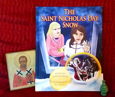 The Saint Nicholas Day snow with an icon of St. Nicholas and a tiny porcelain Christmas tree