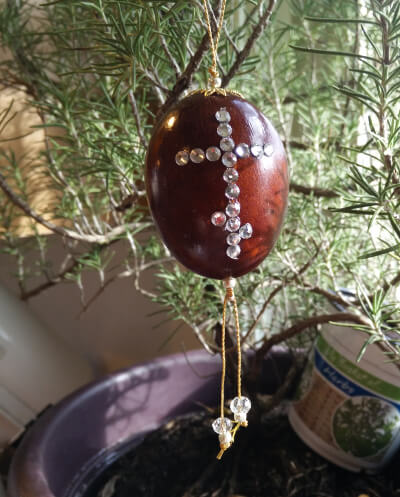 """red egg ornament with """"gemstone"""" cross"""