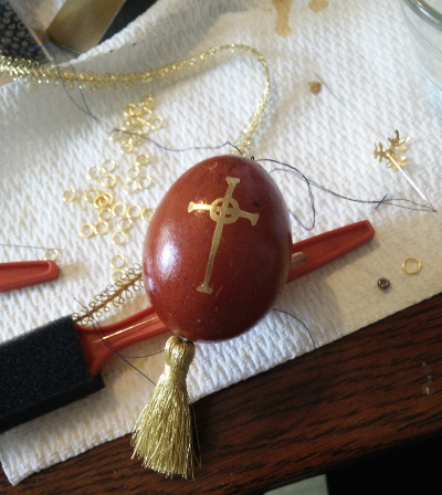red egg with a gold celtic cross